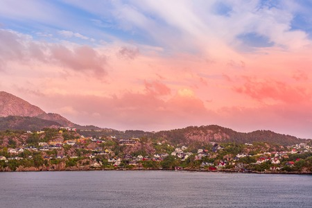 Norwegian colorful landscape with sunset over fjord and mountain village, Norway 版權商用圖片