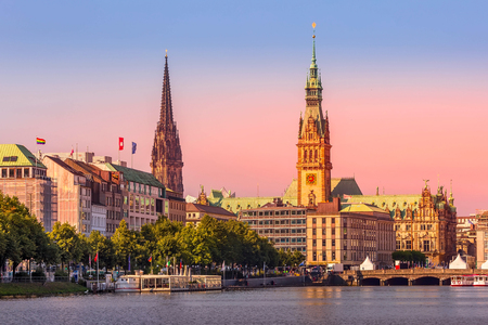 Hamburg, Germany colorful pink sunset or sunrise view of city center with town hall and Alster lake