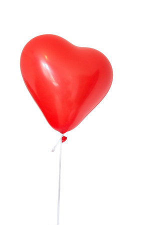 Romantic or festive concept. Heart shaped red balloon on white background