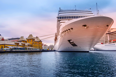 Cruise ship in Stavanger, Norway city harbor and traditional wooden houses view Standard-Bild - 118476024