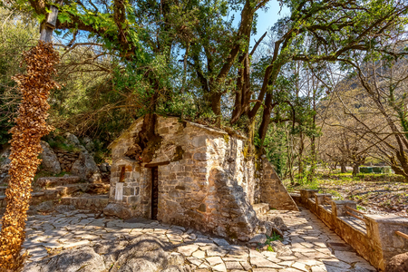 Agia Theodora miracle church in Peloponnese, Greece. Trees growing on the roof without roots inside