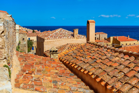 Monemvasia old red brick houses, roofs in ancient town and blue sea view, Peloponnese, Greece 版權商用圖片