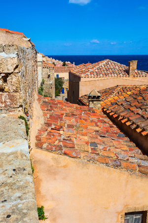 Monemvasia old houses, roofs in ancient town and sea view, Peloponnese, Greece