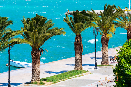 Promenade with palm trees sea in Nafplio or Nafplion, Greece, Peloponnese