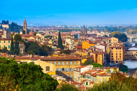 Florence, Italy city panorama with Oltrarno houses Santo Spirito tower and Ponte Vecchio bridge across the river Arno 版權商用圖片