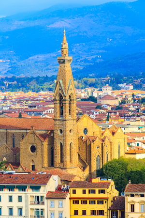 City aerial view with Basilica Santa Croce tower and houses in Florence, Italy