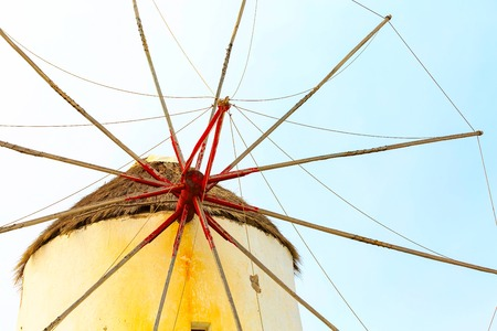Greek iconic windmill close-up background in Mykonos, Greece, famous island in Cyclades 版權商用圖片