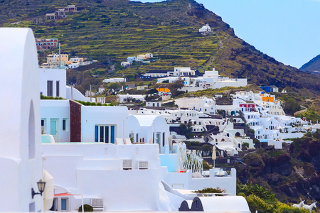 Oia Village in Santorini Island with white and blue houses in Greece