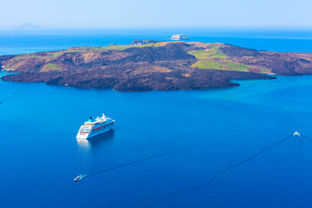 Panoramic sea view from Fira town to caldera, volcano island and cruise ship in Santorini, Thira, Greece Stock Photo