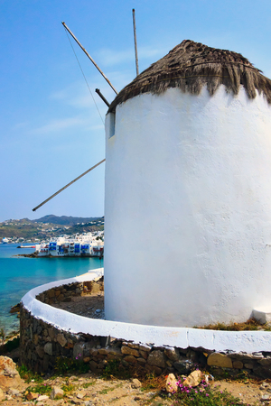 Greek iconic windmill and little venice panorama in Mykonos, Greece, famous island in Cyclades