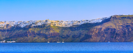 Sunrise panoramic banner of Oia village in Santorini island with colorful houses and blue sea, Greece 版權商用圖片