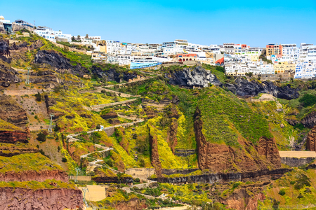 Fira panoramic view, Santorini island with donkey path and cable car from old port, high volcanic rocks in Greece