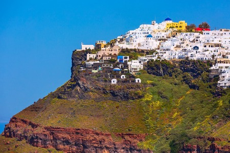 panorama of Santorini island, Greece. Imerovigli town village on the top of volcanic rocks with colorful houses Фото со стока