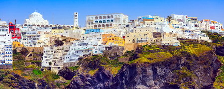 Fira or Thira, Santorini, Greece panoramic banner with white and blue colorful houses on high volcanic rocks
