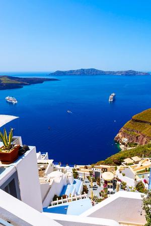 Santorini, Greece iconic view of white houses, caldera, volcano island and sea panorama with cruise ship