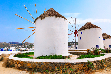 Greek iconic windmills and little venice panorama in Mykonos, Greece, famous island in Cyclades