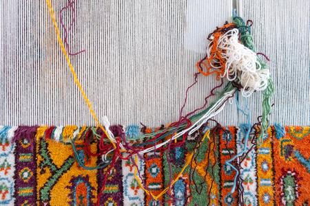 Loom for hand weaving carpet close-up view Standard-Bild - 123492179