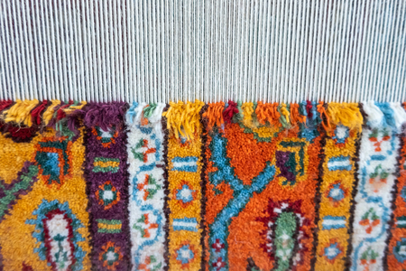 Loom for hand weaving carpet close-up view Standard-Bild - 123492944