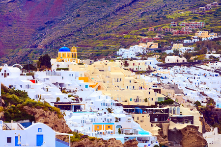 Oia, Santorini, Greece famous village town in cyclades island with white houses panoramic view