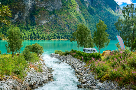 Norwegian camping landscape with fjord and glacier river in Olden, Norway Banco de Imagens