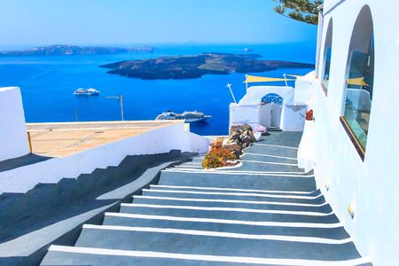 Santorini, Greece white houses architecture, hotels with caldera blue sea view and flowers blossom in famous island Banco de Imagens