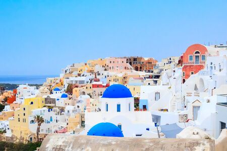 Oia, Santorini, Greece in cyclades island with colorful houses and blue church domes