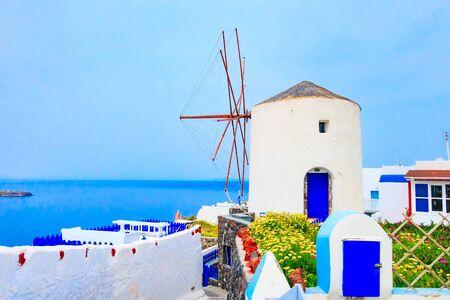 Oia Village in Santorini island, Greece with windmill, white houses and sea Banco de Imagens