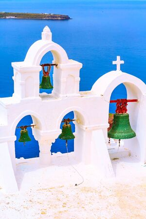 Santorini, Oia, Greece sea and iconic view of white church bell tower Banco de Imagens