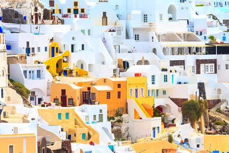 Oia, Santorini, Greece famous village town in Cyclades island with colorful houses panoramic view Banco de Imagens