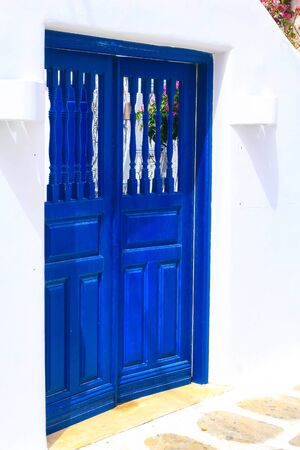 Greek traditional architecture, street view with white and blue house door close-up Banco de Imagens