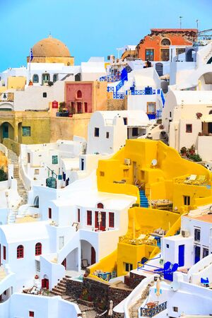 Oia, Santorini, Greece famous village town in Cyclades island with colorful houses and church dome view