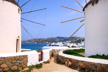 Greek iconic windmills and little venice panorama in Mykonos, Greece, famous island in Cyclades Banco de Imagens