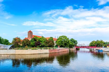Wroclaw, Poland panorama of Ostrow Tumski island, Odra or Oder river and red bridge Stock Photo