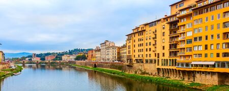 Florence, Italy city view with traditional italian houses, Arno river, Boboli gardens and Piazzale Michelangelo far away Stock fotó