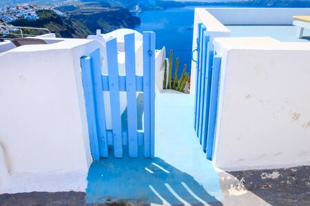 Santorini island, Greece architecture, blue door with caldera blue sea panoramic view