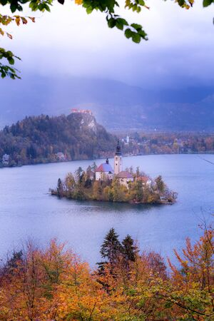 Lake Bled with Church of the Assumption of Maria, Slovenia and autumn colorful trees background