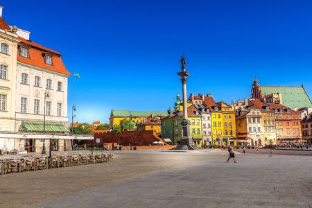 Warsaw, Poland - June 24, 2019: Colorful houses and Sigismund Column in Castle Square in the Old Town of polish capital