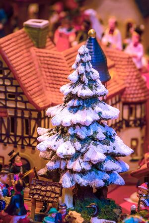 European market fair stall with different traditional gift Christmas tree in Nuremberg, Germany