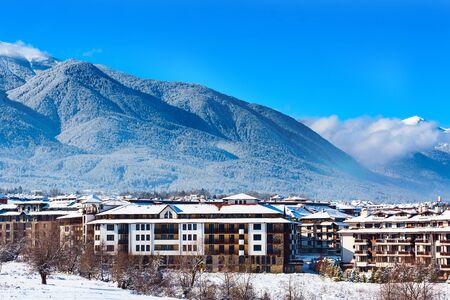 Bansko, Bulgaria houses and Pirin snow mountain peaks landscape panorama in bulgarian ski resort
