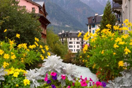 Chamonix Mont-Blanc, France river and autumn street view with flowers in city center of famous ski resort located in Haute Savoy province