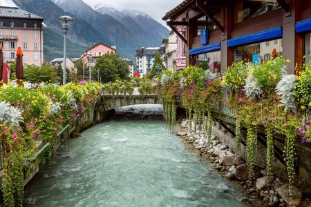 Chamonix Mont-Blanc, France river and autumn street view with flowers in city center of famous ski resort located in Haute Savoy province Stock Photo