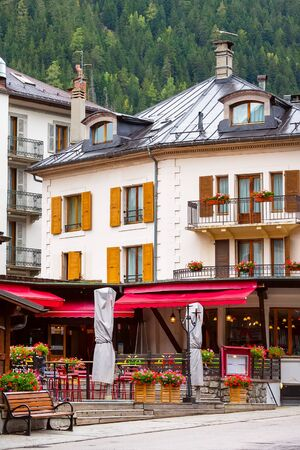 Chamonix Mont-Blanc, France autumn view of the street, cafe decorated with flowers in the center of famous ski resort in French Alps Stock Photo