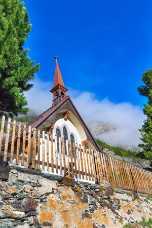 Zermatt, Switzerland St Peter anglican church, snow mountains and blue sky, copy space