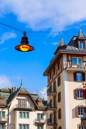 Zermatt, Switzerland town view in famous swiss ski resort, colorful traditional houses, mountains and street light