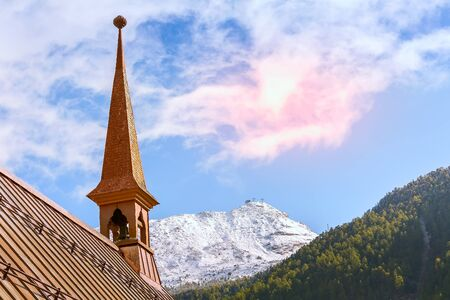 Zermatt, Switzerland St Peter anglican church, snow mountains and sunset pink and blue sky, copy space