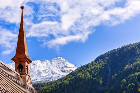 Zermatt, Switzerland St Peter anglican church, snow mountains and blue sky, copy space Imagens