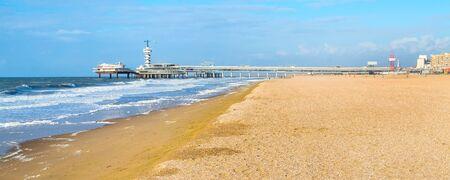 North Sea beach and Scheveningen Pier near Hague, Holland, the Netherlands banner panoramic Stock Photo