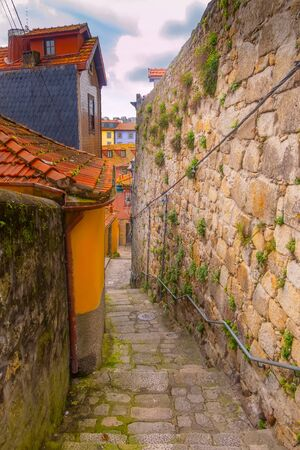 Porto, Portugal old town narrow street view with colorful traditional houses and Douro river