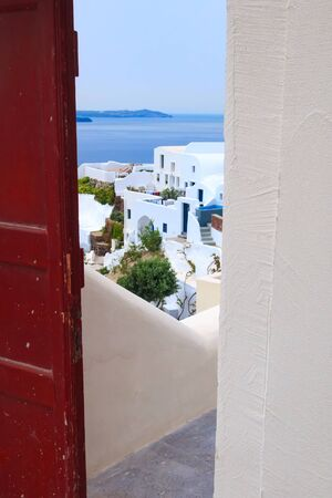 Santorini island, Greece architecture, entrance door with caldera blue sea panoramic view