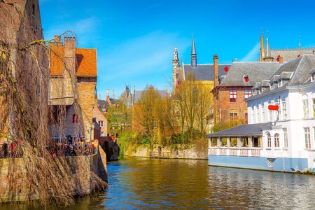 Bruges, Belgium iconic cityscape with medieval houses, towers and Rozenhoedkaai canal